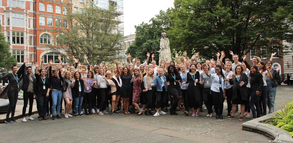 Girl Effect team (waving)